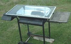 West's Solar Oven Cooking Cart in action closeupssmaller.  I have an old grill that would be perfect as a solar cooker!!