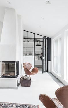 Modern Living Spaces // minimal white can still be cozy in this modern interior // via Coco Lapine Design
