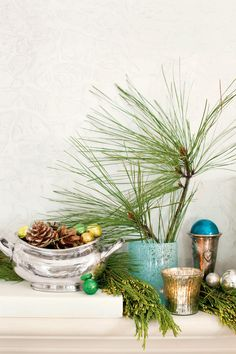 Use Indigenous Accents - Holiday Decorating with Seaside Style - Southernliving. For a native, not store-bought feel, try cutting from your own yard. Tuck pine into vases on the mantel and into the tree. Real pinecones as well as silver faux ones can be placed around the house to continue the theme.