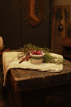 I love this little vignette...the berries & greens & the little bowl..my kind of decorating.....