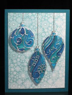 handmade Christmas card ... trio of silver embossed baubles ... monochromatic blue ... stamped on vellum ... colored from behind with markers ... look like stained glass ...