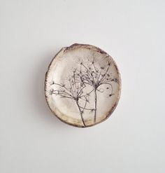 Let this unique ceramic trinket dish bring a beautiful touch of nature into your home! This piece has an organic free form shape which was slab