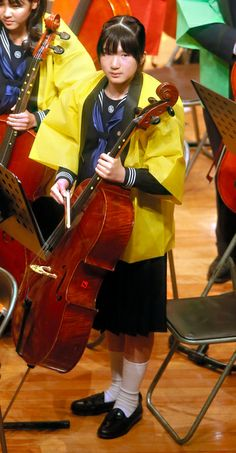 Princess Aiko of Japan, shown with her cello, along with her father Crown Prince Naruhito, performed with the All Gakushuin University Orchestra at Gakushuin University, Tokyo, April 13, 2014