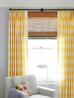 Sunny and Stylish:  A fresh carpet pattern echoes the vintage window muntins. Mirrors and brass add glimmer to a room that gets little natural light. Creamy white paint on doors and moldings also keeps things bright. Layering curtains over shades gives a luxe look. (We turned the fabric 90 degrees to get a room-stretching horizontal stripe.)