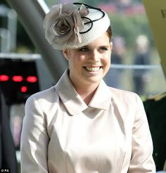 All smiles: Princess Eugenie before presenting to the winner of the Ascot Stakes...