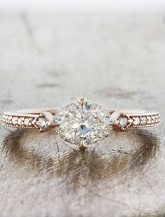 Charleen oozes vintage flair, with a 0.82ct H VS2 horizontal oval diamond in flanked by 0.18tcw of brilliant round diamonds, nestled in a rose gold band.