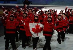 The Canada Olympic team enters the Opening Ceremony of the Sochi 2014 Winter Olympics at Fisht Olympic Stadium on February 2014 in Sochi, Russia. (Photo by Pascal Le Segretain/Getty Images) Winter Olympic Games, Winter Olympics, O Canada, Canada Travel, World Athletics, Olympics Opening Ceremony, Olympic Team, Olympians, Best Games