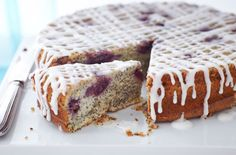This lovely poppy seed and cherry cake is topped with a drizzle of lemon icing for a delicious Mother's Day bake | Tesco
