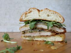 Louisiana chef Donald Link makes his schnitzel with mustard instead of eggs; topped with capers, Swiss cheese, and arugula, it makes a pretty mean sandwich.