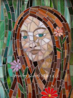 Jennifer Kuhn does beautiful stained glass mosaics. She showed her work at the National Mosaic Exhibiton on Cape Cod 2011
