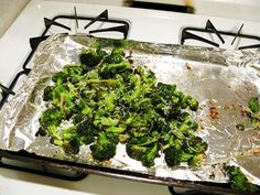 "Put the broccoli on a cookie sheet. Toss with olive oil, salt and pepper. (She says 5 Tbs olive oil, 1 1/2 tsps kosher salt, 1/2 tsp fresh ground pepper, but I just eyeballed it.) Now add 4 garlic cloves that are peeled and sliced and toss them in too.Roast in the oven 20 to 25 minutes @425, until ""crisp-tender and the tips of some of the florets are browned."" add lemon zest & juice, parm cheese, and serve"
