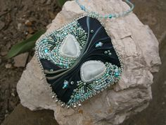 Bead embroidered necklace with shibori silk and synthetic larimar.