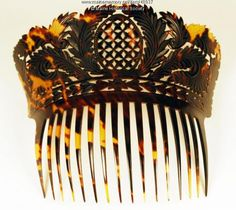 Hair comb, ca. 1820. An elaborately carved woman's hair comb made of tortoiseshell features tiny crosses in the center, surrounded by a laurel wreath and sprays of laurel. Large hair combs -- many of which rose above the hair on the back of the head -- were popular adornments for evening and other fancy occasions, especially in the 19th century. Item # 48937 on Maine Memory Network