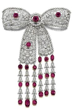 AN IMPORTANT RUBY AND DIAMOND DEVANT DE CORSAGE, EARLY 20TH CENTURY. Designed as…