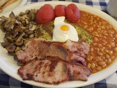 9 types of #breakfast from around the world. Pictures is the iconic #english breakfast. #Yummy.