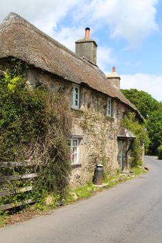 typical roadside old village cottage