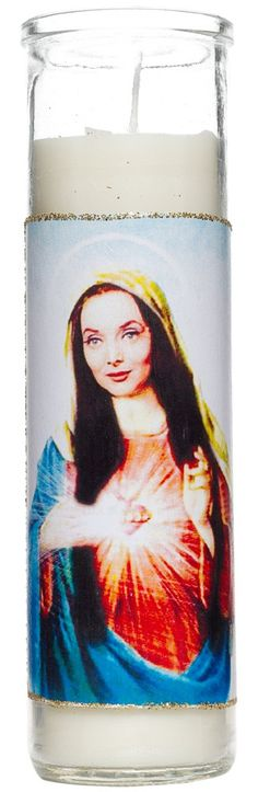 SAINT MORTICIA ADDAMS PRAYER CANDLE  Bask in the other worldly glow of Saint Morticia!