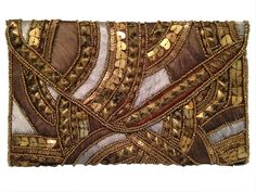 Bronze multi fabric Statement Accessory clutch... lots of luxe for little $$ @ Heel to Toe Spring 2016