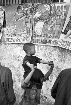 Henri Cartier-Bresson CHINA. Jiangsu. Nankin. April 1949. Students post their drawings that were done during the last days of the Kuomintang.