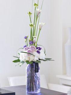 Featuring lilac/white vermeer calla lilies, white snowball hydrangeas, lilac…