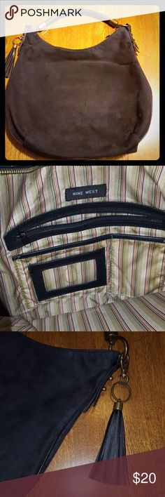 "Nine West Black Suede Hobo Bag Nine west suede-like black mid to large size hobo bag. Woven leather handle and 4 1/2"" black tassel - zip closure. Heavy duty patinaed bronze fittings  Interior has 1 zip pocket and 2 small accessory pouches. Bag measures 17"" wide x 13"" tall (in the center).   Very good used condition. Smoke free and pet free home. Nine West Bags Hobos"
