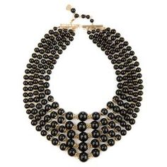 """Stunning and regal, this tiered necklace features black beading for complementing any ensemble.   Product: NecklaceConstruction Material: Metal and resin Color: BlackFeatures:  Lead-freeNickel-free5"""" H dropDimensions:  18"""" ChainCleaning and Care: Do not get wet or use jewelry cleaner"""