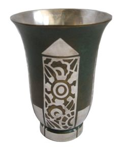 """French art deco dinanderie vase designed ca. 1925 for Orfeverie CHRISTOFLE, Paris by Luc LANEL (1893-1965). The vase, with it's geometric floral designs, flaring rim and straight foot is in silver plated brass w/ green to brown oxidized patina and has a silver plated interior. It is stamped on the base """"Christofle"""", """"B013"""" and """"E"""". (hva)"""