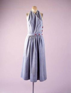 This is a sundress by American designer Claire McCardell. This is an ensemble by American designer Claire McCardell. McCardell is known for creating very functional, sturdy pieces and also for helping cultivate an American look. This dress is made of cotton and dated 1943.