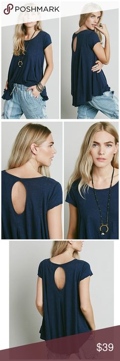 WE THE FREE SYLVIE TEE FREE PEOPLE TOP T SHIRT NEW Washed circle-shaped tee in an oversized, spacious fit. Features and a cutout in back and pleat detailing. Raw hem. Color: NAVY blue   We The Free $78 retail price. Brand new without the tag inner label marked perfect condition   FP EXCLUSIVE :Only sold thru Free People. One of nine exclusive, in-house labels. Perfectly distressed, all-American styles.  52% Linen 48% Cotton Hand Wash Cold Import Free People Tops Tees - Short Sleeve