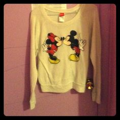 "White sweater with Minnie and Mickey Mouse. This is a thin, white sweater with Minnie and Mickey Mouse ""kissing"" on the front. It was only worn once, and has no holes, stains or anything else like that. Tops Blouses"