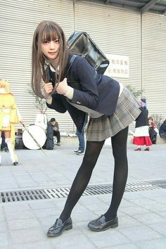Asian Schoolgirl cosplay on the street. bent forward, slightly smiling at viewer. School Girl Japan, Japan Girl, Japanese School Uniform, School Uniform Girls, Girls Uniforms, Cute School Uniforms, Cute Asian Girls, Cute Girls, Beautiful Japanese Girl