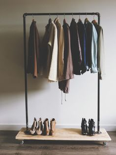 Furniture. Diy Clothes Rack Design Inspiration. Industrial Pipe Movable Clothes Rack With Industrial Pipe Garment Rack And Stainless Steel Clothes Hanger Plus White Stain Wall Together With Varnished Wood Floor Tile