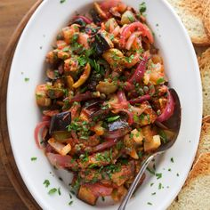 A colorful mix of eggplant, red onions, tomato sauce, olives and capers make up the backbone of this sweet and sour Sicilian staple.