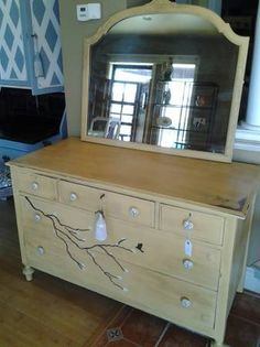 Antique dresser painted in Annie Sloan Arles yellow paint. Hand painted branch and hummingbird. Distressed and crackle technique used.