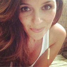 Aynur Abbott rocks the Sun single earring...