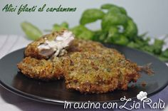 le alici fritte al cardamomo con ripieno filante sono un secondo piatto di pesce veramente buono e gustoso. Entrate per la ricetta con foto passo passo