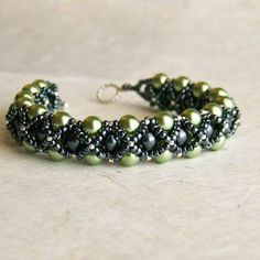 Bracelet, Green and Black Pearl with Sterling Silver Toggle Clasp, Handwoven, Peridot Green, Gunmetal Black. Made to Order.. $60,00, via Etsy.