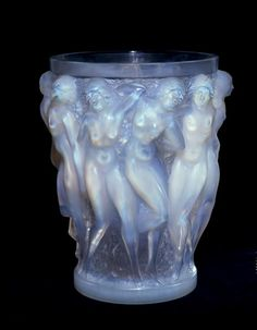 Rene Lalique, vase 'Bacchants', Paris, circa 1924; glass. Height 24.5 cm. this vase by Rene Lalique shows a transition from Art Noveau to Art Deco. I love the detail and the subject matter don't you?
