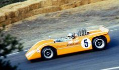 Denny Hulme, M8A Laguna Seca practice 1968. John Cannon won this race, famously held in very wet conditions when so many 'fell off the Island'. Cannon's old McLaren M1B Chev won from Hulme and George Eaton's McLaren M1C Ford (tamsoldracecarsite.net)