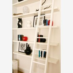 A decorative shelf or series of shelving units can nicely show off your figurines or books or vintage record collection. This functional design element can also break up a span of wall and give you more ways to get organized.