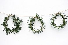 I love the simplicity of these DIY Christmas decorations - an idea for your home this season? Mini Wreath Garland by The Merry Thought. A branch with a simple white candle (Please advise on Noel Christmas, Simple Christmas, Winter Christmas, Christmas Crafts, Christmas Decorations, Holiday Decorating, Decorating Ideas, Christmas Lights, Christmas Ideas