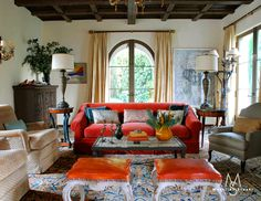 Love this arched window and dark coffered ceiling coupled with the bright pops of color.