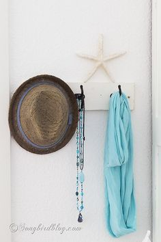 Bedroom decor. Summer decoration, wall decor, pretty board with hooks via http://www.songbirdblog.com Home Bedroom, Bedroom Decor, Extra Bedroom, Bedroom Wall, Master Bedroom, Nautical Bedroom, Coastal Cottage, Cottage Style, Home Decor Inspiration