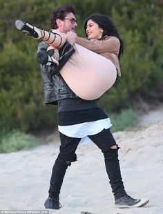 Swept off her feet: Kylie Jenner got a helping hand on Wednesday while visiting rapper boy...