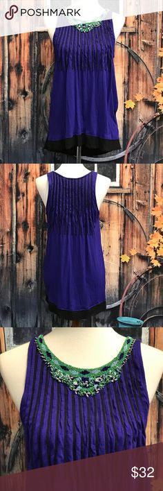 """Anthropologie Ric Rac Tunic Absolutely Stunning Anthropologie Brand Ric Rac Tunic! Gorgeous Deep Purple Color with a Multi-Colored Beaded Neckline. Pleated Accents  on Upper Half of Tunic, Front and Back. Black Raw Edged Hem. Stretchy. 100% Rayon. Perfect Condition! Wear with Skinny Jeans or Leggings and some Cute Wedges! Measurements Taken Laid Flat Are: Armpit to Armpit 19"""".  Waist  22"""" Length in Front 26.5""""   Length in Back 29"""".  Smoke and Pet Free Home. Anthropologie Tops Tunics"""