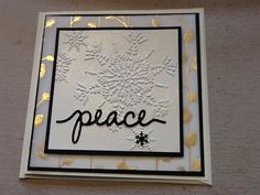 Stampin Up 2015 Autumn/Winter Catalogue: Winter Wonderland Designer Vellum, black and vanilla card stock, snowflake embossing folder, spritz of vanilla glimmer mist and word cut on black glitter card stock using the Christmas Greetings Thinlits. Black snowflake from a Martha Stewart border punch.