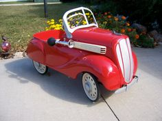 Vintage pedal car from mid to late 1930s in dazzling red now for sale. Original antique beautifully restored. At FreshRetroGallery, $1600.00