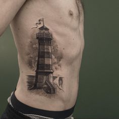 Black and Grey Ink Lighthouse Tattoo by Sven Rayen