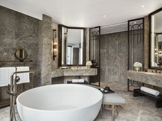 The interiors are a clever interplay of classic versus modernity, with an intricate juxtaposition of cultural influences that, to Andre Fu, represent Hong Kong. Featuring a Claybrook Bathtub.
