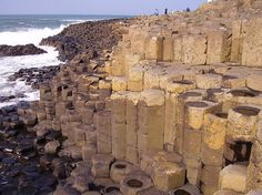 Giants Causeway – County Antrim, Ireland  The Giant's Causeway was formed 50 to 60 million years ago when hot lava flowed onto chalk beds, cooled quickly and contracted to make hexagon shaped piers. The speed that the lava cooled determined the height of the shafts. Although the scientific explanation might be simple, figuring out all the varying Irish myths surrounding the Giant's Causeway is not.    They all pretty much tell the story of an Irish warrior who built a bridge to walk to…